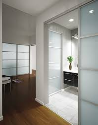 white kitchen windowed partition wall: furniture frosted glass room partition with stainless steel frames connected by brown wooden floor