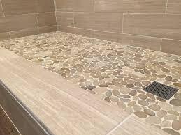 lay pebble tile floor diy  comtemporary  bathroom with pebble floor on sliced java tan pebble ti
