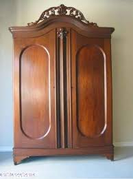 1850s double door armoire with a pierced carved curved crown inside this fabulous american antique armoire are shelves lovely rounded corners with a antique mahogany armoire