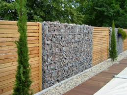 Small Picture ideas for garden fencing Garden fence of natural stone and wood