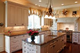 kitchen cabinets with granite countertops: counter tops are granite richly designed white kitchen with cabinet back lighting ornate island with sink and dark