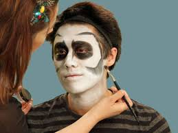 add bony contours to skeleton makeup by using a flat craft brush to apply black cream