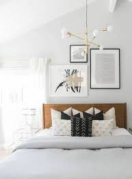 modern guest room decor with brass light fixture and wooden headboard bedroom layout design