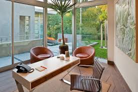 modern home office with red leather chairs and floor to ceiling windows blue modern home office