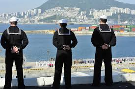 hospital corpsman hm navy enlisted rating 11 2013 sailors man the rails as the aircraft carrier uss nimitz