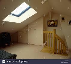 Loft Conversion Bedroom Design Cream Carpet In Sparsely Furnished Loft Conversion Bedroom With