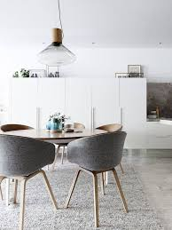 scandinavian dining room with hay aac 23 chairs covered with kvadrat upholstery available on chair aac22