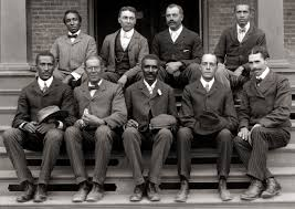 a comparison between booker t washington th century and english george washington carver front row center poses fellow staff members