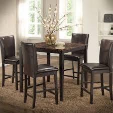 person dining room table foter: it is a dining table that is perfect for small space in dining room and it fits for four chairs and four plates it has got a faux marble finished top and
