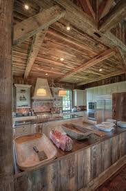 reclaimed wood beams and barn boards in a party barn kitchen barn boards