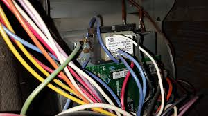 add c wire for thermostat to goodman furnace home improvement my question is should i connect to the 24v terminal on the board or one of the wires that are screwed into the metal next to the transformer