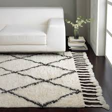 charming white 5x7 area rugs on wooden floor plus white sofa before the white wall for charming shag rugs