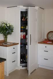 kitchen corner cabinet pinterest cabinets a corner fridge with white wood paneling to match the kitchen units a