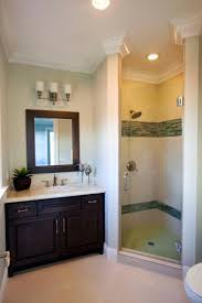 bathroom furniture raya diy cabinets easy artisan this simple guest bathroom features a walk in shower and dark brown va