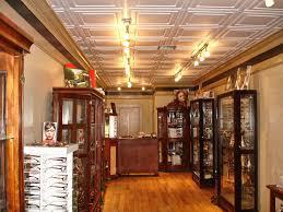 sagging tin ceiling tiles bathroom:  white stratford tiles in a retail store