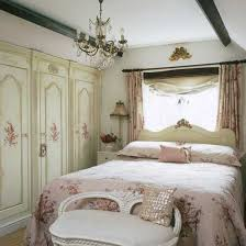 floral designs and antique furniture transform this bedroom into a antique inspired furniture