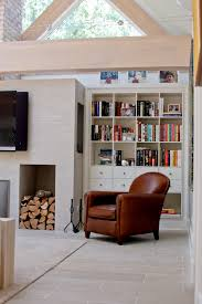 heatwarming room decor ideas chic isokern fireplaces with television and white wooden book case plus brown leather sofa on white chic family room decorating ideas