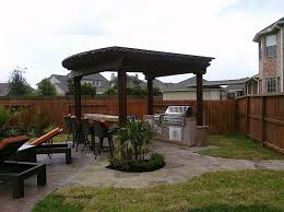 outdoor kitchen granite flagstone alderete pools grill pergola backyard barstools rockfrog backyard escapes