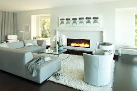 blue sectional sofa living room contemporary with dark flooring fireplace glass blue dark trendy living room