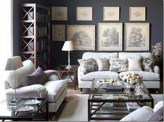 blue grey living room with black white tree illustrations and white upholstered furniture blue gray living room