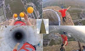 Natural high! Daredevil scales 840ft chimney and performs tricks ...