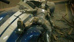 stark trashed on his sports car after his mark ii lost power and fell through his house bedroom upstairs tony stark