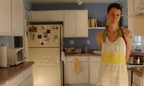 kitchen moldings: pretty woman in kitchen wife wearing apron in kitchen pretty woman in kitchen