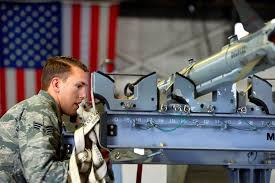 u s department of defense photo essay air force senior airman nicolas sampson unstraps munitions in preparation to load them onto an f