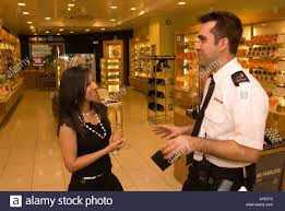 security guard chatting to store worker whilst out on patrol in security guard chatting to store worker whilst out on patrol in lewisham shopping centre london uk