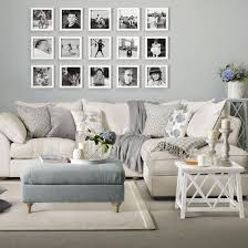 furniture living room wall: family living room with picture gallery personalise your living room with an arrangement of favourite family photographs a bare expanse of wall above the