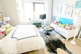 couch bedroom sofa: amazing bedroom with sitting area featuring collection of art over white sofa accented with turquoise throw blanket green greek key lumbar pillow and pink