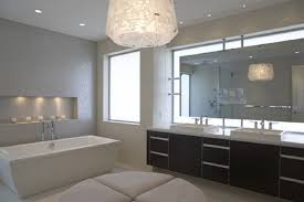 modern pendant light in white shade bathroom lighting design and white freestanding bathtub also double vanities in square sinks under wide mirror facing bathroom pendant lighting double vanity