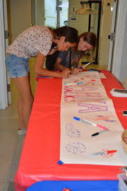 photo essay sahaya walks quarter claireisbold key club project coordinator helene levy and mikaela manzano sign the welcome banner for the