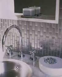 kitchen backsplash stainless steel tiles: stainless steel subway tile backsplash laid vertically