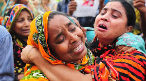 When the building he owned collapsed, entombing hundreds of garment workers beneath its choking rubble, Mohammed Sohel Rana vanished. - Bangladeshi-relatives-of--016