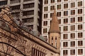 the old anz headquarters on the corner of queen and collins streets has a gothic style anz office melbourne