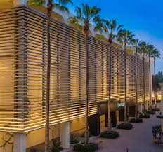 bloomingdales in newport beach ca first circle design llc beautifully illuminated the exterior using beach style balcony helius lighting group