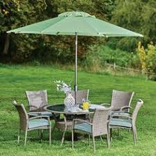 barker and stonehouse tropea round table and 6 armchairs barker furniture