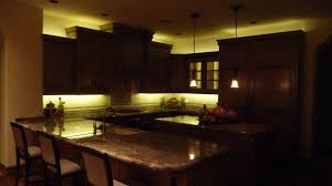 chic strip led kitchen above cabinet lighting