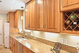 kitchen cabinets with granite countertops: in the musterics kitchen  hickory cabinet granite countertops in the musterics kitchen