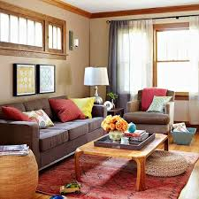 brown sofa colorful pillows and rug bhg bhg living rooms yellow