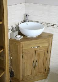 bathroom vanity unit units sink cabinets: corner bathroom vanities are a perfect option to those who want to make the most of space in their bathrooms if you install a vanity in the corner there