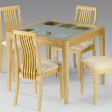 m attractive forsted glass dining table with unfinished wooden frame and square tapered leg as well as wooden dining chairs which has lath backrest plus attractive high dining