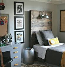 love the vintage industrial look of this little boys bedroom especially the headboard and boys bedroom lighting
