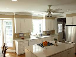 kitchen moldings: low ceiling kitchen with crown molding white cabinets and gloss countertop