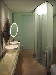 bathroom designs luxurious: small modern bath with narrow glass shower
