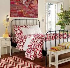 not so sure about the red but i love the black metal bed and the black bed with white furniture