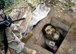 Resultado de imagem para saddam hussein preso em um buraco