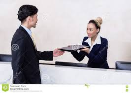 applicant giving his documents to receptionist stock photo image applicant giving his documents to receptionist
