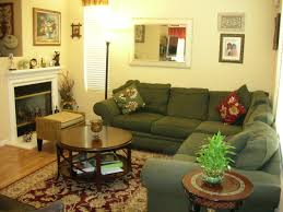 green black mesmerizing: green army fabric sofa combine with round brown wooden table on the brown cream rug combined